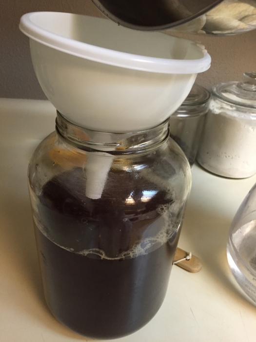 STEP NINE- Pour your cooled sweet tea in the jar. *make sure it has cooled. If it's too warm it can kill the scoby!